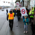 Workers and supporters rally at the Hilton Anchorage on March 6. The union has contracted with a building inspector in an effort to better understand the causes of mold growth reported at the hotel in 2014 and to prevent its recurrence.